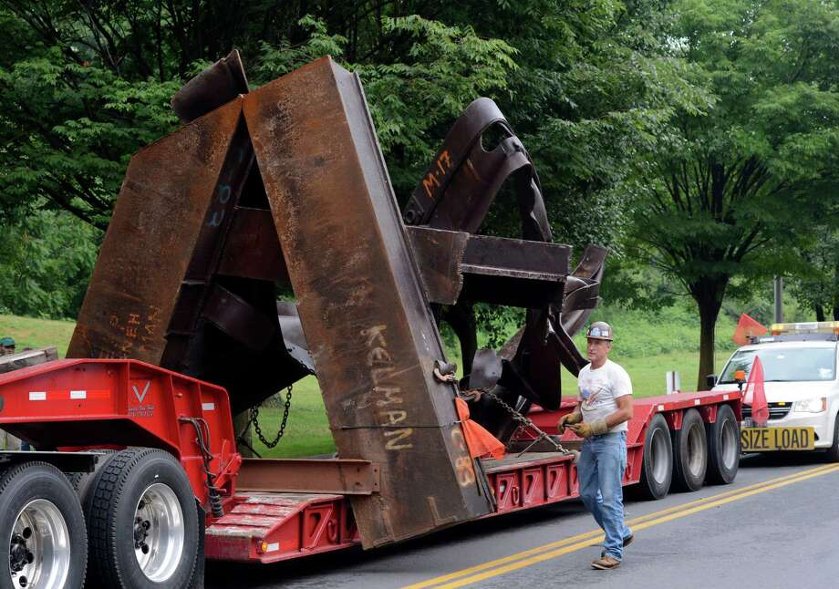 "The sculpture ""Tempered by Memory"" a 9/11 sculpture made from the World Trade Center steel was transported to the High Rock Park in Saratoga Springs, N.Y. July 24, 2012.     (Skip Dickstein/Times Union) Photo: Skip Dickstein / 00018465A"