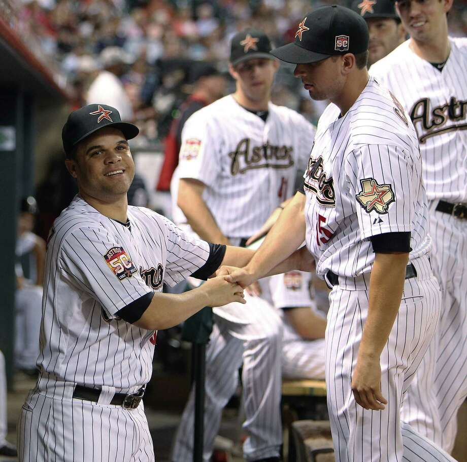 Pitcher Wandy Rodriguez (left) shakes hands with his ex-teammates shortly after finding out he was traded to Pittsburgh. Photo: AP