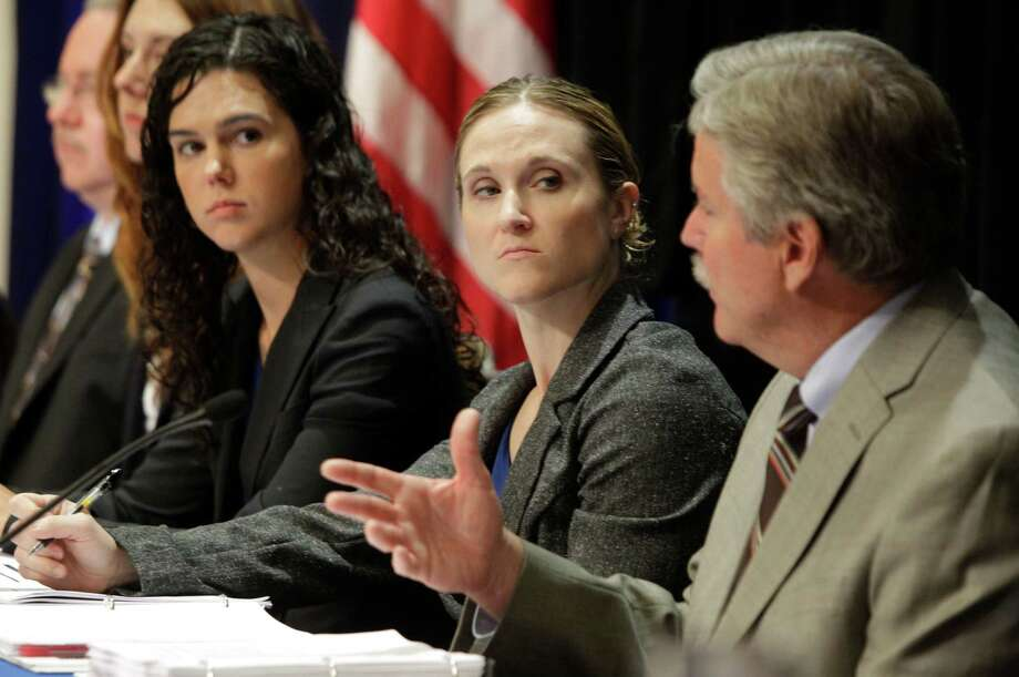 Chemical Safety Board investigator Kelly Wilson, left, and investigations team lead Cheryl MacKenzie listen as Don Holmstrom, director of the western regional office of investigations, speaks at Tuesday's hearing. Photo: Melissa Phillip / © 2012 Houston Chronicle