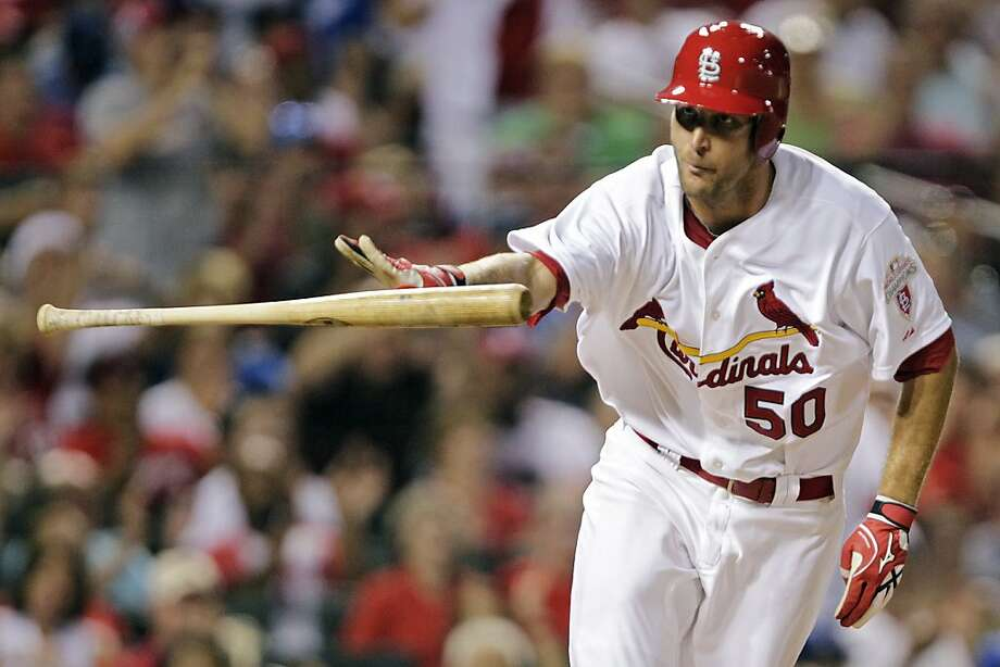 St. Louis Cardinals starting pitcher Adam Wainwright tosses his bat after drawing a bases-loaded walk in the sixth inning of a baseball game against the Los Angeles Dodgers, Tuesday, July 24, 2012, in St. Louis. (AP Photo/Tom Gannam) Photo: Tom Gannam, Associated Press