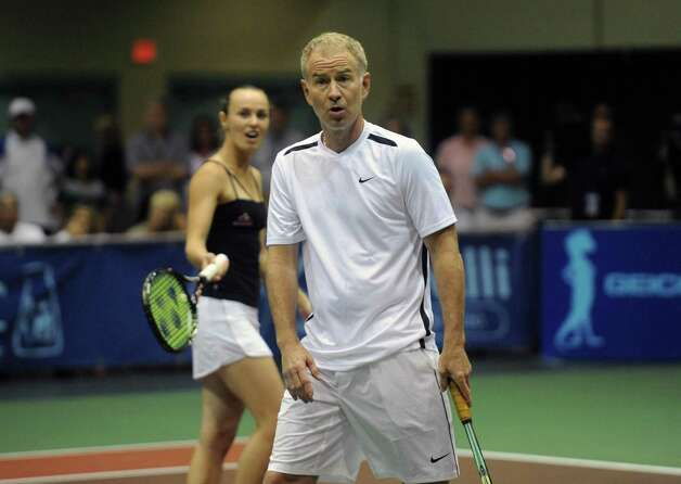 Tennis great John McEnroe disputes a line call with the official during a doubles match with partner Martina Hingis as his New York Sportimes take on the Boston Lobsters at HVCC in Troy NY Tuesday July 24, 2012. (Michael P. Farrell/Times Union) Photo: Michael P. Farrell