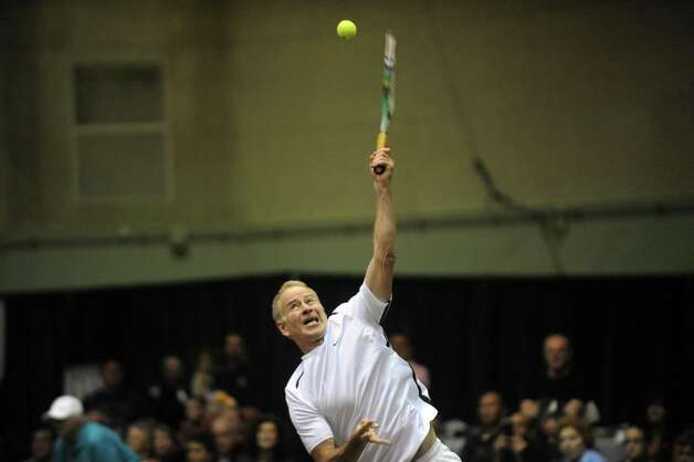 Tennis great John McEnroe serves during a doubles match with partner Martina Hingis as his New York Sportimes take on the Boston Lobsters at HVCC in Troy NY Tuesday July 24, 2012. (Michael P. Farrell/Times Union) Photo: Michael P. Farrell