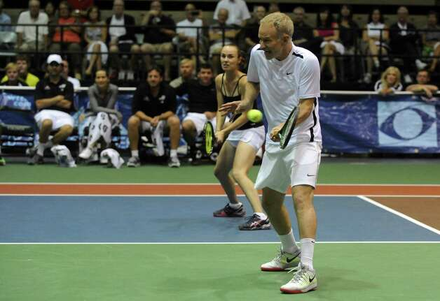 Tennis great John McEnroe makes a return during a doubles match with partner Martina Hingis as his New York Sportimes take on the Boston Lobsters at HVCC in Troy NY Tuesday July 24, 2012. (Michael P. Farrell/Times Union) Photo: Michael P. Farrell