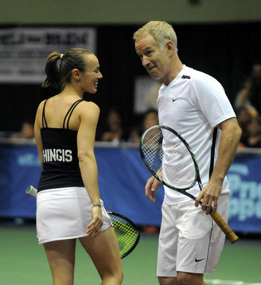 Tennis great John McEnroe talks with doubles partner Martina Hingis as his New York Sportimes take on the Boston Lobsters at HVCC in Troy NY Tuesday July 24, 2012. (Michael P. Farrell/Times Union) Photo: Michael P. Farrell