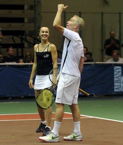 Tennis great John McEnroe motions up after a great return during a doubles match with partner Martina Hingis as his New York Sportimes take on the Boston Lobsters at HVCC in Troy NY Tuesday July 24, 2012. (Michael P. Farrell/Times Union) Photo: Michael P. Farrell