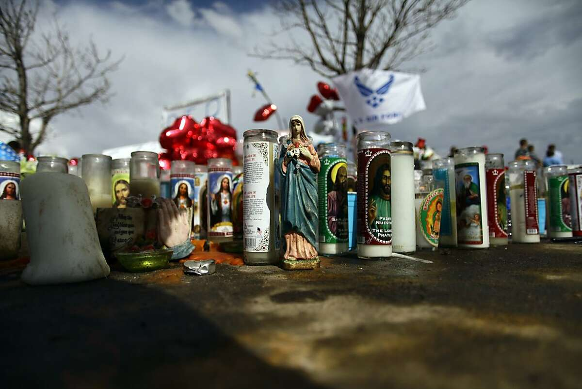 AURORA, CO - JULY 24: The Virgin Mary and candles are placed a memorial across the street from the Century 16 movie theatre July 24, 2012 in Aurora, Colorado. The memorial was created for the victims that were killed during a mass shooting at the movie theater last Friday. Twenty-four-year-old James Holmes is suspected of killing 12 and injuring 58 others during a shooting rampage at a screening of 'The Dark Knight Rises.' (Photo by Joshua Lott/Getty Images)