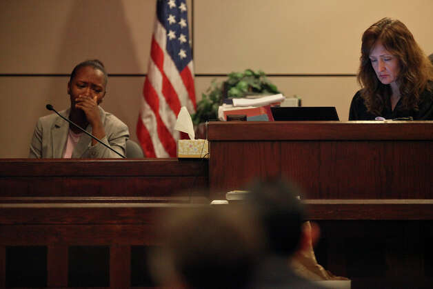 Defendant Tiffany James, 20, testifies in her murder trial for the death of Antwan Wolford, the father of her child and her boyfriend at the time, in the Bexar County 399th District Court with Judge Juanita Vasquez-Gardner, right, on Tuesday, July 24, 2012. Photo: Lisa Krantz, San Antonio Express-News / SAN ANTONIO EXPRESS-NEWS