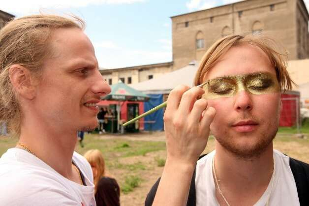 BERLIN, GERMANY - JULY 21:  An attendee gets his face painted with glitter at the second annual Hipster Olympics on July 21, 2012 in Berlin, Germany.  (Adam Berry / Getty Images)