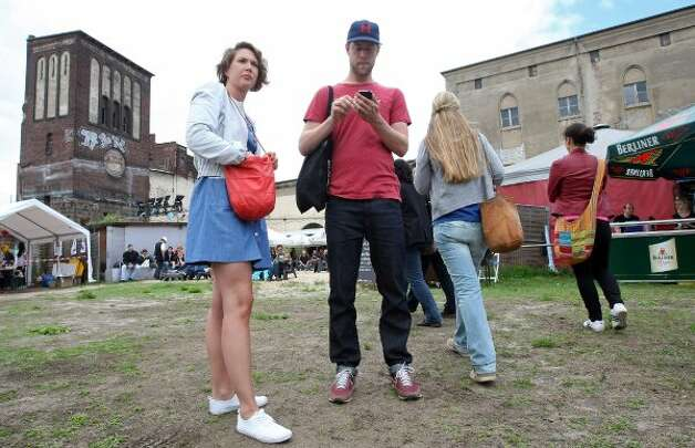 BERLIN, GERMANY - JULY 21:  Attendees wait for the start of the games at the second annual Hipster Olympics on July 21, 2012 in Berlin, Germany.  (Adam Berry / Getty Images)