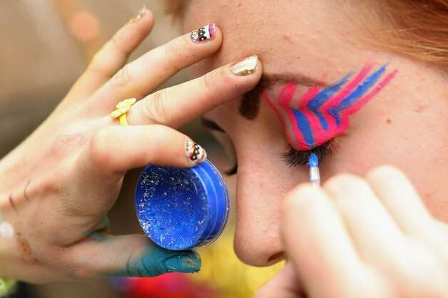 BERLIN, GERMANY - JULY 21:  An attendee gets her face painted with glitter at the second annual Hipster Olympics on July 21, 2012 in Berlin, Germany. (Adam Berry / Getty Images)