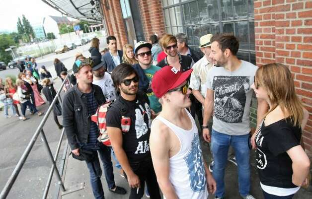BERLIN, GERMANY - JULY 21:  Attendees wait in line to enter the second annual Hipster Olympics on July 21, 2012 in Berlin, Germany. (Adam Berry / Getty Images)