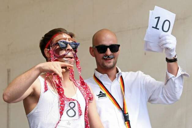 BERLIN, GERMANY - JULY 21:  A contestant receives a judge's verdict in the make-your-own-ironic-Hipster-moustache competition at the second annual Hipster Olympics on July 21, 2012 in Berlin, Germany.  (Adam Berry / Getty Images)