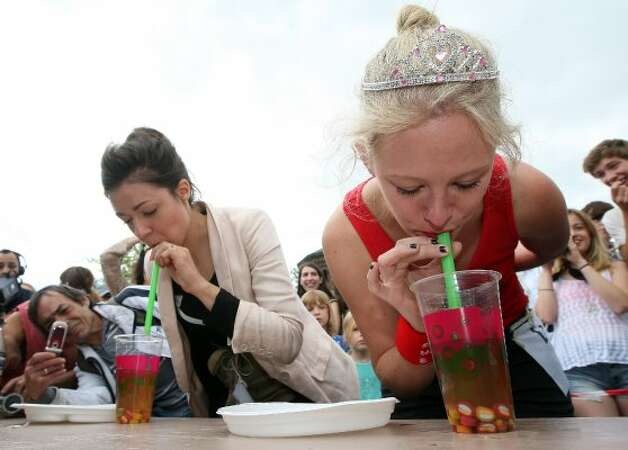 BERLIN, GERMANY - JULY 21:  Contestants compete in an event in which they must suck candy out of a cup of the ubiquitous Berlin drink bubble tea during the second annual Hipster Olympics on July 21, 2012 in Berlin, Germany. (Adam Berry / Getty Images)