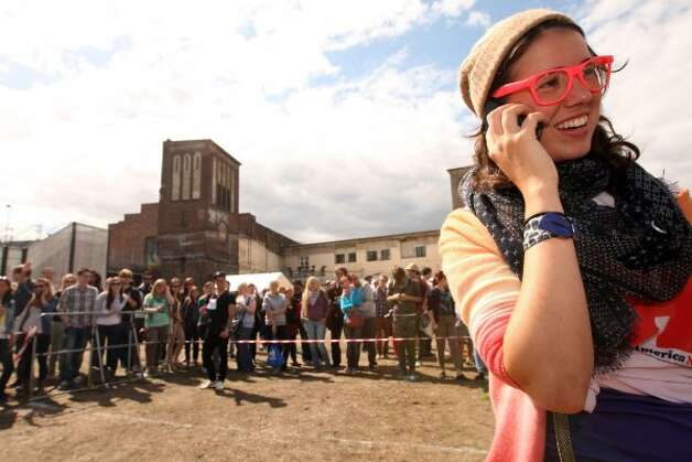 BERLIN, GERMANY - JULY 21:  An attendee wearing pink glasses speaks on a mobile phone during the second annual Hipster Olympics on July 21, 2012 in Berlin, Germany. (Adam Berry / Getty Images)