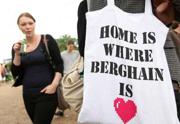 BERLIN, GERMANY - JULY 21:  A visitor carries a cloth tote bag advertising the Berlin dance club Berghain during the second annual Hipster Olympics on July 21, 2012 in Berlin, Germany.  (Adam Berry / Getty Images)
