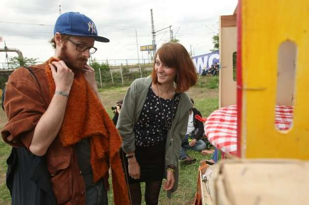 "BERLIN, GERMANY - JULY 21:  Attendees look at items from a ""swap box,"" where visitors can take items in exchange for leaving others, at the second annual Hipster Olympics on July 21, 2012 in Berlin, Germany. (Adam Berry / Getty Images)"