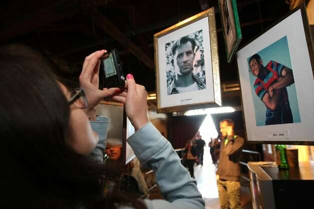 "BERLIN, GERMANY - JULY 21:  An attendee takes a photo of ""early Hipsters,"" author Jack Kerouac and  ""Family Matters"" sitcom character Steve Urkel, at the second annual Hipster Olympics on July 21, 2012 in Berlin, Germany.  (Adam Berry / Getty Images)"
