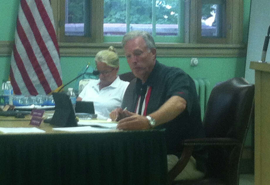 Roger Williams, New Canaan Town Council member, makes a case for why he opposes a resolution to change the vesting period for an elected official under the pension plan to be four years instead of five. The amendment, and two others, are passed by the Town Council at its meeting Wednesday, July 18, 2012. New Canaan, Conn. Photo: Thomas Michael