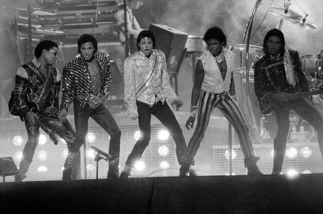 Michael Jackson with the Jacksons on the 1984 Victory Tour. (AP) / SF