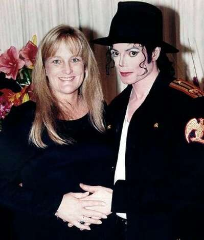 Michael Jackson with second wife, Debbie Rowe. (Sony) / SF