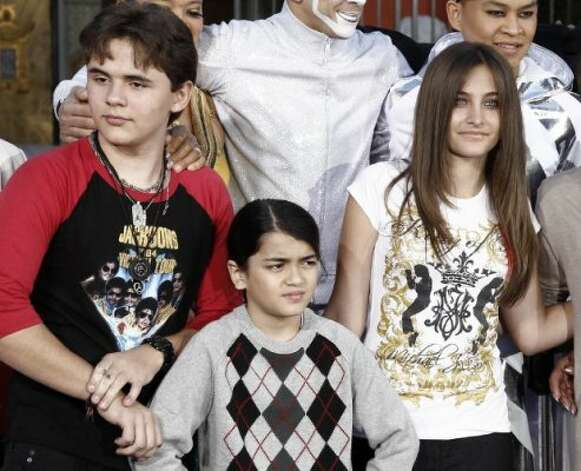 Prince Jackson, Blanket Jackson and Paris Jackson after a hand and footprint ceremony honoring their father musician Michael Jackson in front of Grauman's Chinese Theatre in Los Angeles, 2012. (AP) / SF
