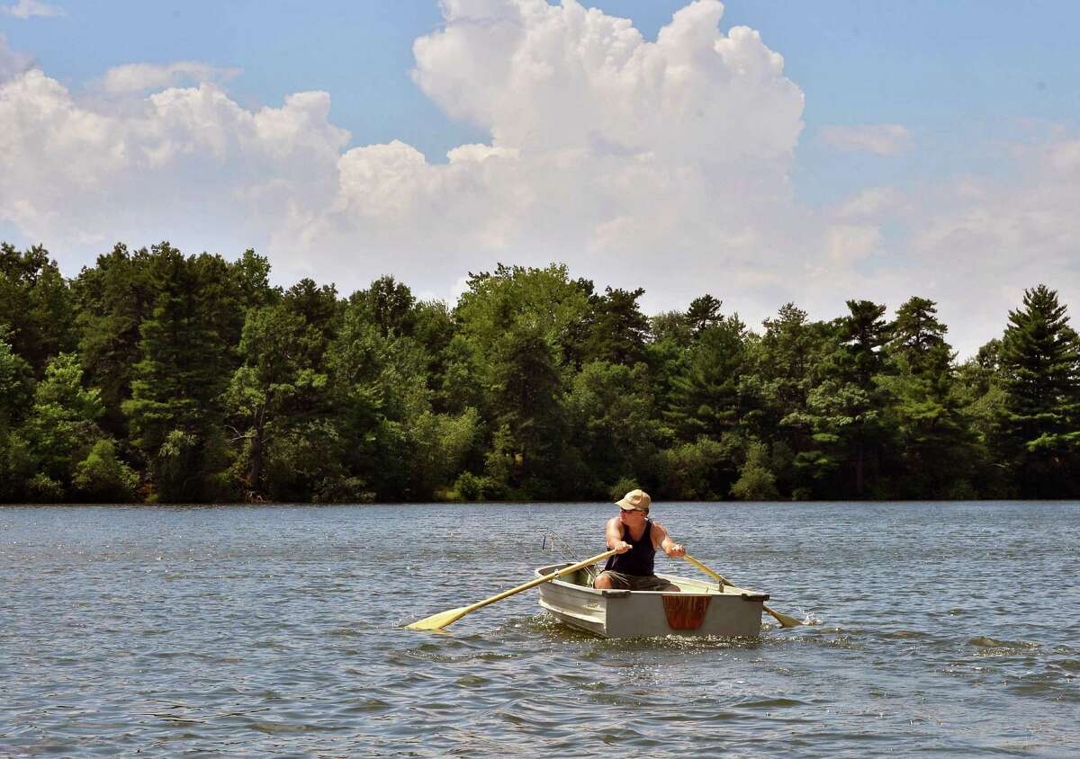 Mitch Poland of Guilderland rows out onto Rensselaer Lake for a little bass fishing at Albany's Six Mile Waterworks Tuesday July 24, 2012. (John Carl D'Annibale / Times Union)