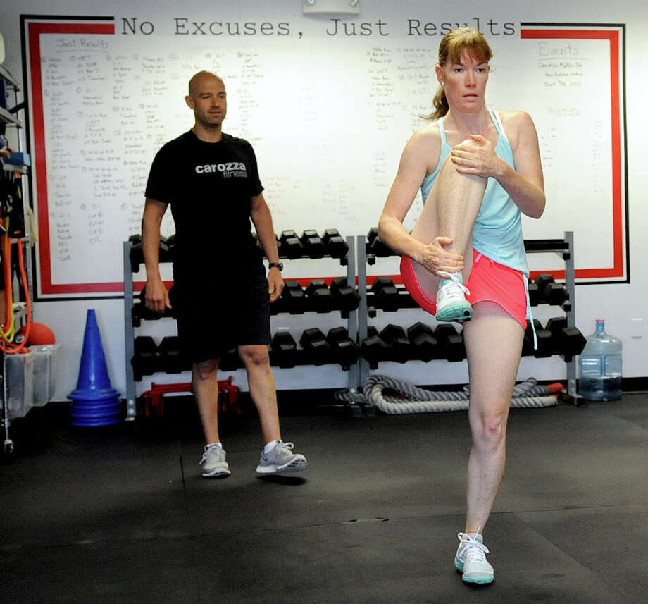 Teresa Fellows works out with personal trainer Michael Carozza at Carozza Fitness in Stamford on Thursday, July 12, 2012. Photo: Lindsay Niegelberg / Stamford Advocate