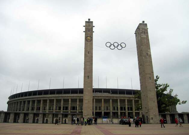 This Sept. 25, 2010 photo shows the Olympic rings on the approach to Olympiastadion Berlin, where U.S. gold medalist Jesse Owens won four gold medals during the 1936 Summer Olympics in Berlin, Germany. Germany hosted two notorious games: The 1936 Berlin Olympics, which Adolf Hitler tried to turn into a showcase of Aryan supremacy, and the 1972 Munich Olympics, married by a hostage crisis that left 11 Israelis dead. A tour takes you to the stands overlooking the track area where Owens and other athletes competed. Photo: AP