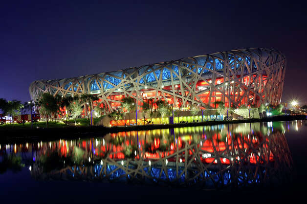 FOR METRO - The National Stadium is reflected in a waterway, Tuesday Aug 5, 2008 in Beijing, China, during the final rehearsal for the opening ceremonies of the 2008 Beijing Olympics which will be held Friday Aug. 8, 2008. Photo: EDWARD A. ORNELAS, Eornelas@express-news.net / SAN ANTONIO EXPRESS-NEWS