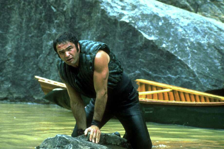 "This image released by Warner Bros. Entertainment shows actor Burt Reynolds portraying Lewis Medlock in the 1972 film ""Deliverance."" Four decades ago, the lush northeast Georgia mountains were introduced to the world in the hit film ""Deliverance.""  Though many in the region still bristle at the movie's portrayal of locals as uneducated, toothless hillbillies who sodomize visitors from the big city, the film helped create the $20 million rafting and outdoor sports industry along the Chattooga River, which splits Georgia and South Carolina and was the fictional Cahulawassee River in the movie. That's why the communities along the Chattooga are celebrating the 40th anniversary of the movie's release with this weekend's first ever Chattooga River Festival.  (AP Photo/Warner Bros. Entertainment) Photo: Associated Press / Warner Bros. Entertainment"