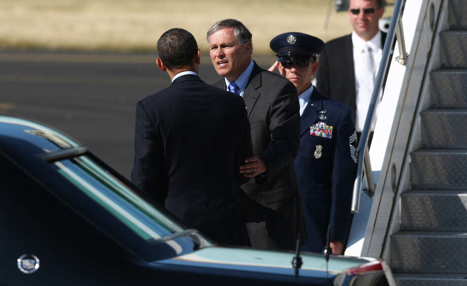 U.S. President Barack Obama talks to Washington State candidate for Governor Jay Inslee as the President prepares to depart Seattle aboard Air Force One at Boeing Field after a fundraising visit for his campaign and an overnight stay in Bellevue. The President departed on Wednesday, July 25, 2012. Photo: JOSHUA TRUJILLO / SEATTLEPI.COM
