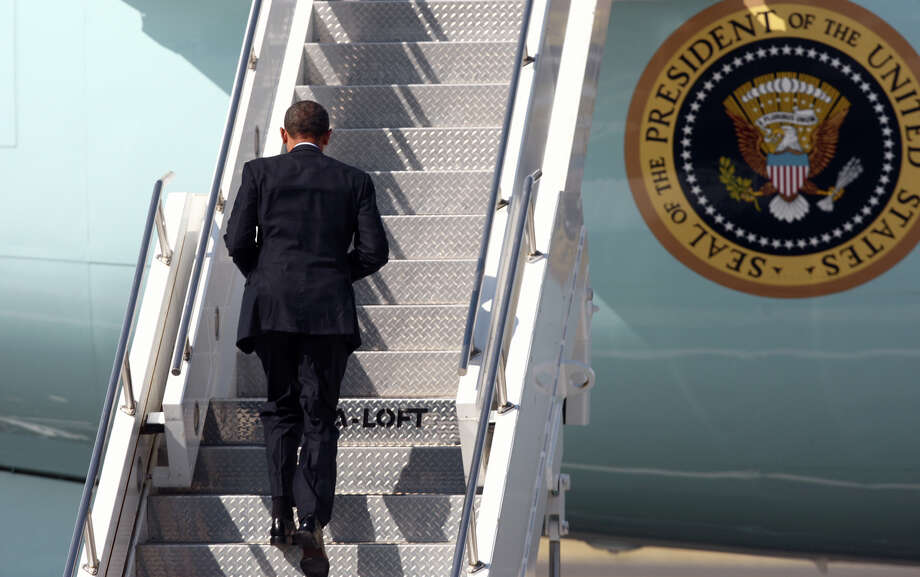 U.S. President Barack Obama walks up the stairs as he departs Seattle aboard Air Force One at Boeing Field after a fundraising visit for his campaign and an overnight stay in Bellevue. The President departed on Wednesday, July 25, 2012. Photo: JOSHUA TRUJILLO / SEATTLEPI.COM