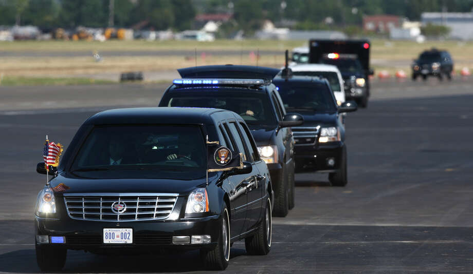 The motorcade carrying President Barack Obama arrives at Boeing Field after a fundraising visit for his campaign and an overnight stay in Bellevue. The President departed on Wednesday, July 25, 2012. Photo: JOSHUA TRUJILLO / SEATTLEPI.COM