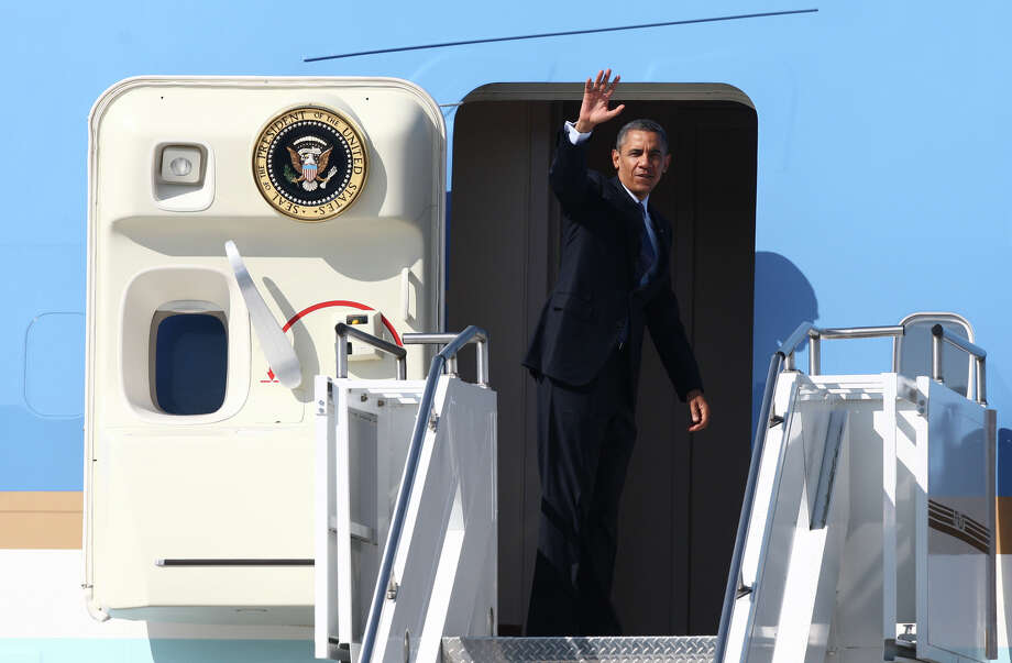 U.S. President Barack Obama waves as he departs Seattle aboard Air Force One at Boeing Field after a fundraising visit for his campaign and an overnight stay in Bellevue. The President departed on Wednesday, July 25, 2012. Photo: JOSHUA TRUJILLO / SEATTLEPI.COM