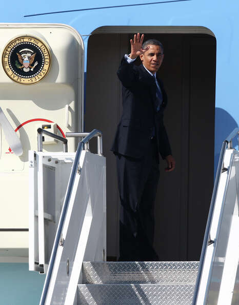 U.S. President Barack Obama waves as he departs Seattle aboard Air Force One at Boeing Field after a