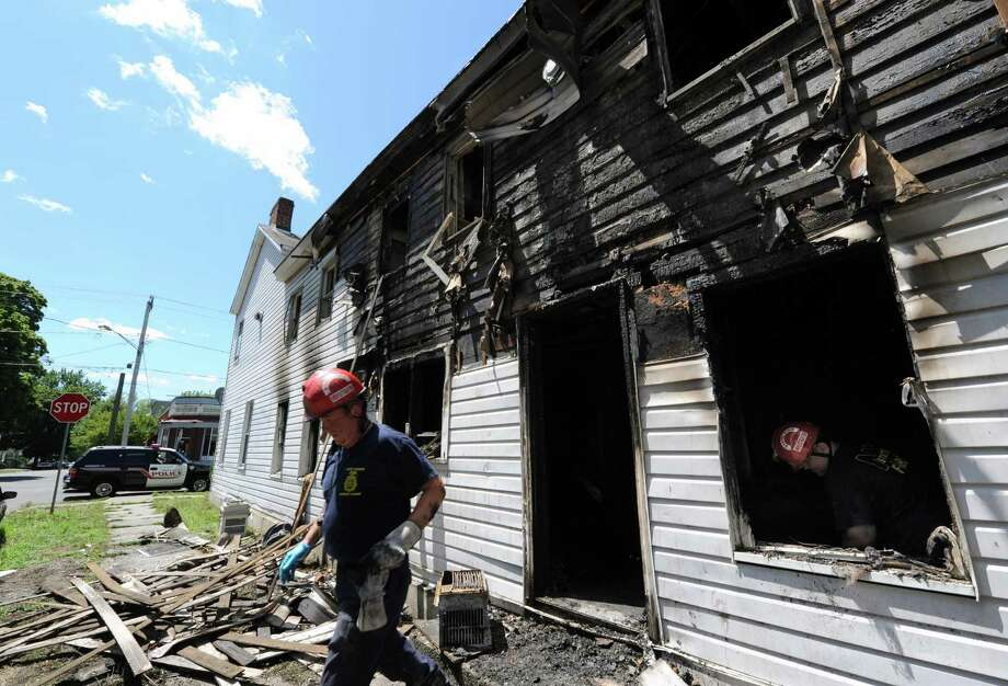 New York State Fire investigators Bill McGivern, left, and Andy Pohl investigate a fire scene at 503 13th Street in Watervliet N.Y., Wednesday July 25, 2012. (Michael P. Farrell/Times Union) Photo: Michael P. Farrell