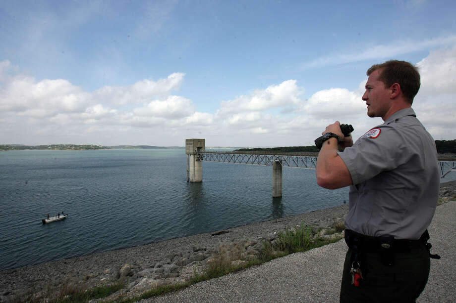 File photo: A Corps of Engineers ranger eyes Canyon Lake from the dam. Photo: Express-News File Photo
