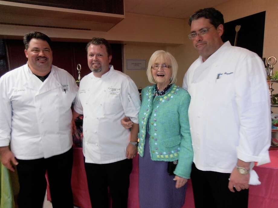 At an announcement party for a culinary training program for high school dropouts, RK Group Chefs Ken Holtzinger, left, Eric Nelson and Jeffrey Magatagan celebrate with their boss, Rosemary Kowalski, for whom the program is named. Photo: Nancy Cook-Monroe, For The Express-News