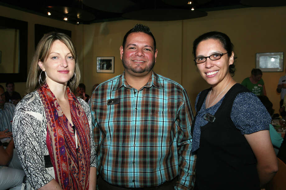 OTS/HEIDBRINK - Speaker Emily Sanderson, from left, and board members Robert Salcido Jr and Ruby Resendez gather at the Lesbian, Gay, Bisexual and Transgender Chamber of Commerce luncheon at Silo on 7/19/2012. This is #1 of 2 photos. names checked photo by leland a. outz Photo: LELAND A. OUTZ, FREELANCER / SAN ANTONIO EXPRESS-NEWS