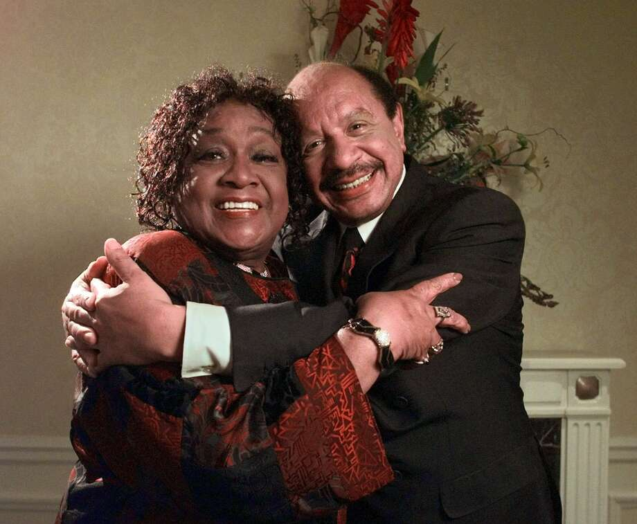 "In this May 6, 1998 file photo, Isabel Sanford, left, and Sherman Hemsley, stars the television sitcom ""The Jeffersons,"" pose for a photograph in New York. Hemsley, the actor who made the irascible, bigoted George Jefferson of ""The Jeffersons"" one of television's most memorable characters and a symbol for urban upward mobility, was found dead Tuesday, July 24, 2012 at his El Paso, Texas home. He was 74.(AP Photo/Kathy Willens, File) Photo: Associated Press"