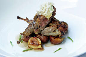 The Gwendolyn Restaurant serves grilled quail with figs on July 3, 2012.