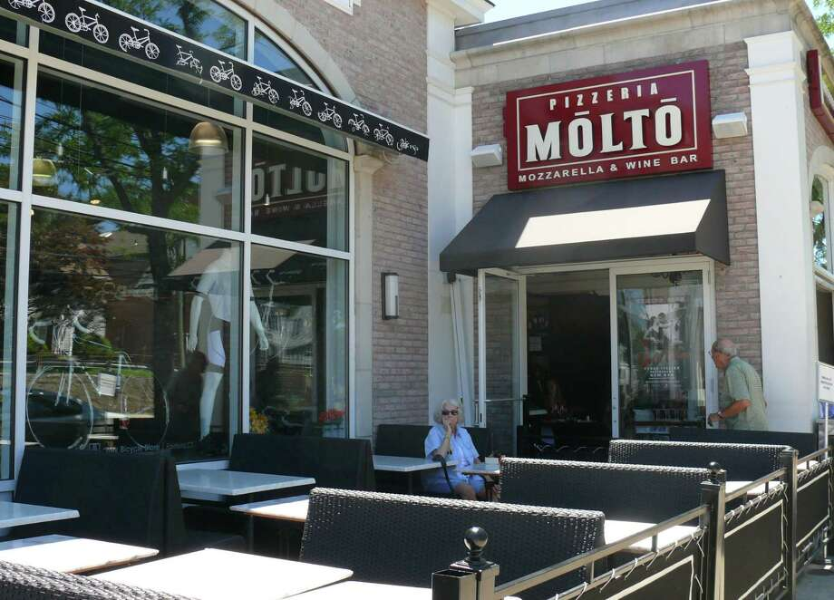 The outdoor tables at Molto were not in use Wednesday during lunch. The Town Plan and Zoning Commission revoked permission for the al fresco dining at its meeting the night before. Photo: Genevieve Reilly / Fairfield Citizen