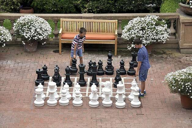 The giant chess board that was added to the brick patio has been in use every day since the hotel started accepting guests. Photo: Christine Delsol, Special To SFGate