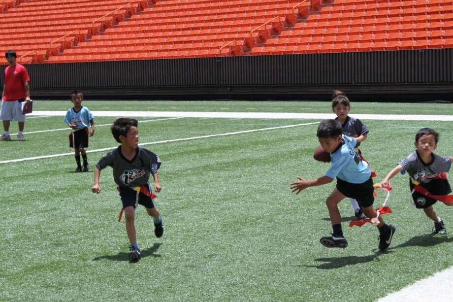 Youngsters pour it on as they play flag football
