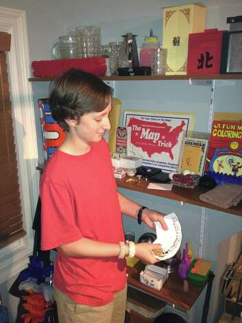 "Teen magician Ben Zabin practices a card trick in his Greenwich home. ""My favorite up-close trick is 'Sleight of Mouth' in which a chosen card appears in my mouth,"" Zabin says. Photo: Contributed Photo"