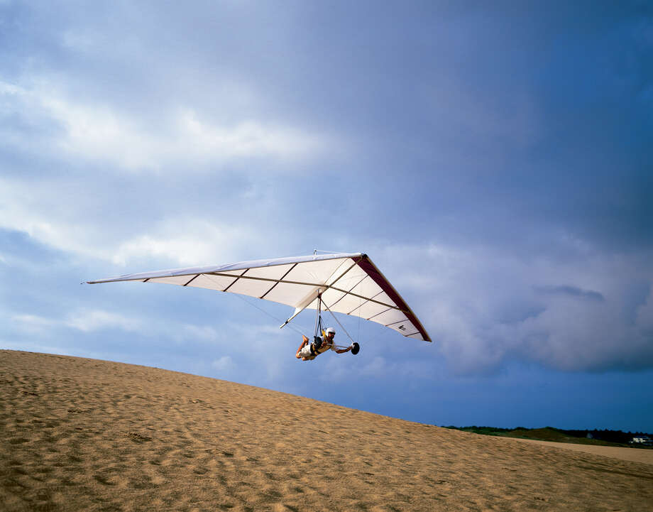 hang gliding from the dunes is a popular activity at the beach on the Outer Banks of North Carolina   credit: Outer Banks Visitors Bureau outerbanks.org / handout