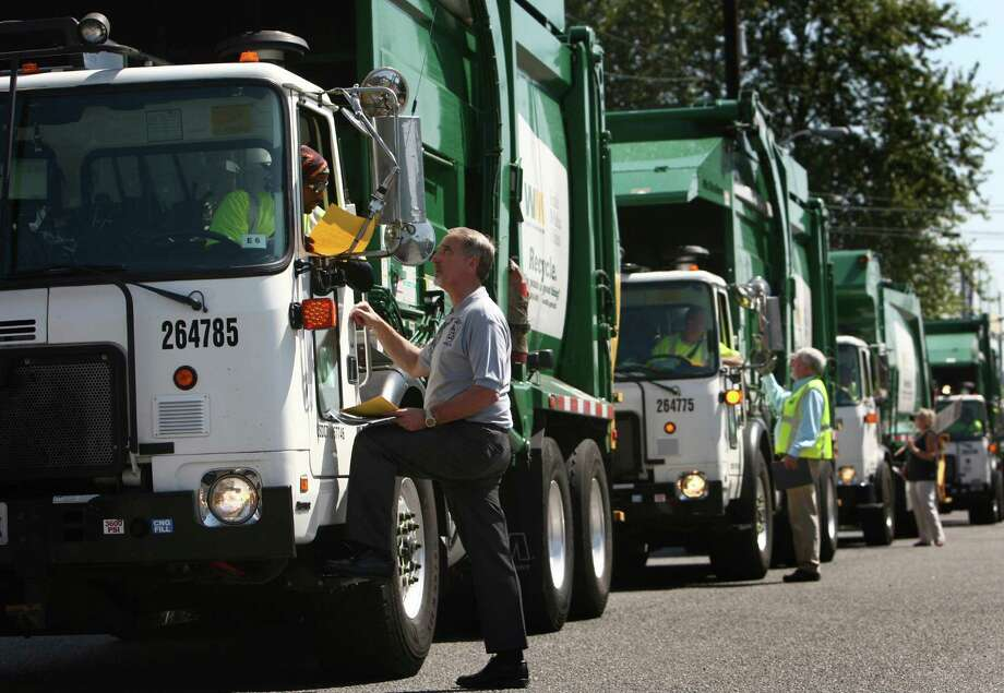 Union representatives tell drivers their rights as the trucks return to their South Park base as members of Teamsters Local 117 begin a strike against Waste Management on Wednesday, July 25, 2012. Drivers that pick up yard waste and recycling are striking and some members of Local 174, the trash haulers union, are expected to honor the picket lines. Photo: JOSHUA TRUJILLO / SEATTLEPI.COM
