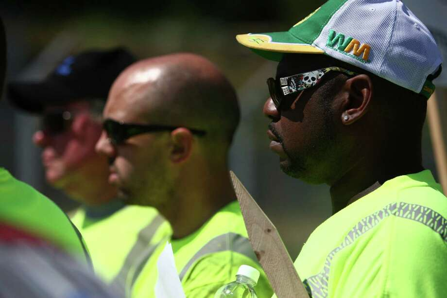 Union members listen to instruction as members of Teamsters Local 117 begin a strike against Waste Management on Wednesday, July 25, 2012. Drivers that pick up yard waste and recycling are striking and some members of Local 174, the trash haulers union, are expected to honor the picket lines. Photo: JOSHUA TRUJILLO / SEATTLEPI.COM