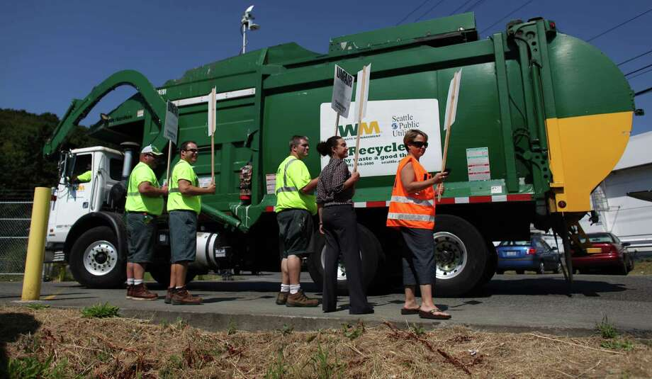 A picket line is set up as trucks return to their South Park base as members of Teamsters Local 117 begin a strike against Waste Management on Wednesday, July 25, 2012. Drivers that pick up yard waste and recycling are striking and some members of Local 174, the trash haulers union, are expected to honor the picket lines. Photo: JOSHUA TRUJILLO / SEATTLEPI.COM