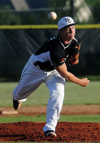 Mid County's Trent Fontenot pitches during an exhibition game against alumni players at Nederland High School in Nederland, Tuesday, July 24, 2012. Tammy McKinley/The Enterprise Photo: TAMMY MCKINLEY
